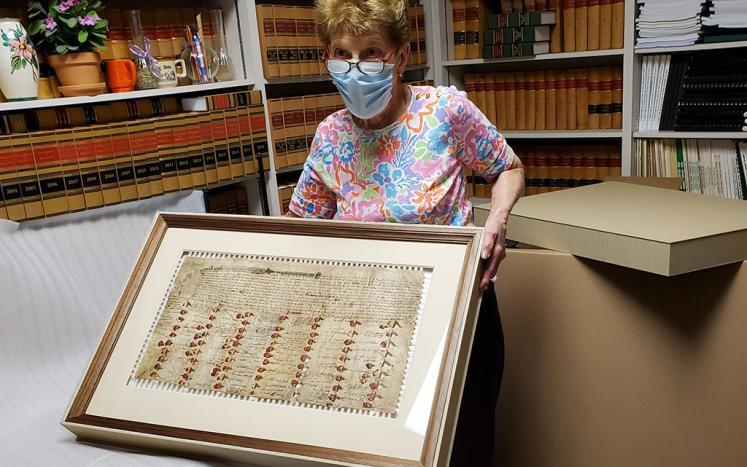Town Clerk Shirley Schult unpacks the Great deed in June 2020